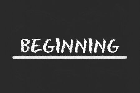 beginning: beginning white script and white underline on a black blackboard Stock Photo
