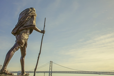 San Francisco statue with the Golden Gate Bridge in the background photo