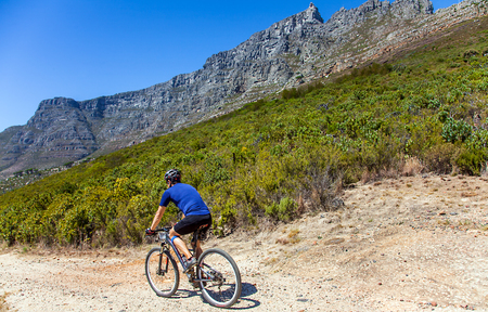 high plateau: Biker at the Table Mountain Cape Town Stock Photo