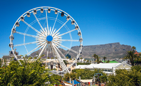 Ferris wheel at the waterfront in Cape Town with Table Mountain