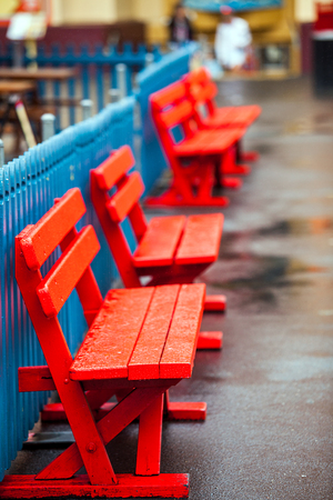 Colorful wooden benches at the Lunapark in Sydney Australia Stock Photo
