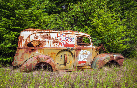 Scrap car at Birkenhead Lake near Pemberton British Columbia Canada