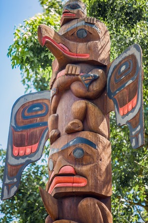 Cedar and Salmon totem pole at the Old Fishing Hole Kent Seattle