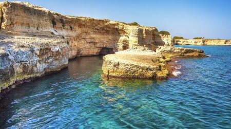 araglioni at Torre Sant Andrea, Italy. Picturesque seascape with cliffs and rocky arch, at Torre Sant Andrea, Salento sea coast, Puglia, Italy