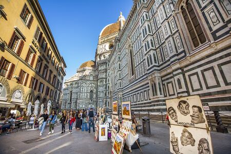 Florence Tuscany Italy on September 30, 2019 Artists exhibit paintings in front of the Duomo in Piazza del Duomo.