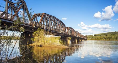 Railway bridge over the Fraser River in Prince George British Columbia Canada Фото со стока