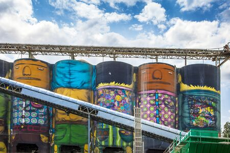 Vancouver British Columbia Canada on June 06, 2018 brightly painted silos in an industrial area