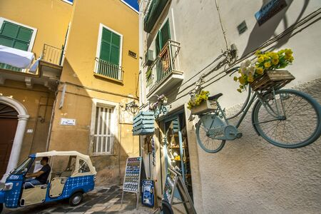 Monopoli Puglia Italy on October 16, 2019 Small car in an alley in the old town Редакционное