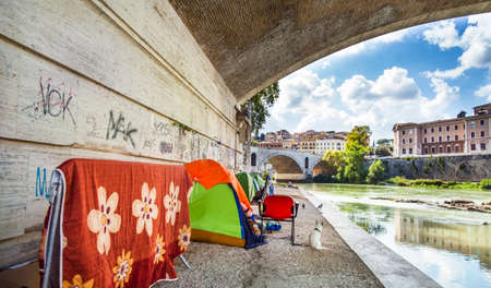 Rome Lazio Italy on October 06, 2019 Tents of homeless people under a bridge on the Tiber