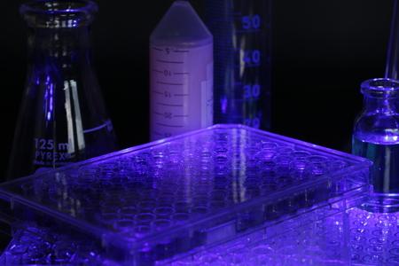 Laboratory equipment, glass and microplates, sterilizing in UV light Stock Photo