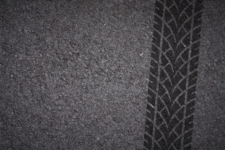 Tire track on asphalt texture Stock Photo
