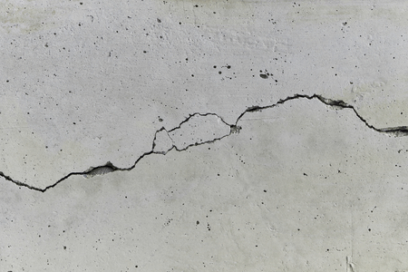 Concrete wall with a long crack