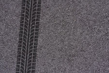 Tire tread marks on asphalt background Foto de archivo