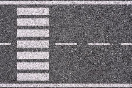 White lines and crosswalk on asphalt texture background