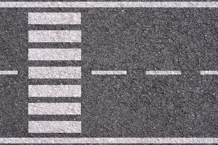 White lines and crosswalk on asphalt texture background