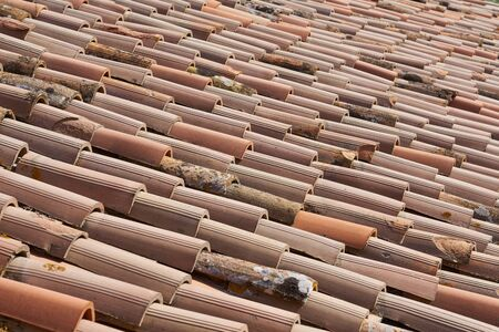 Housetop roofing tiles