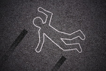 crime scene car accident - shape of body and skidmarks