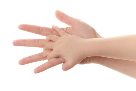 mother and child holding hands on white background