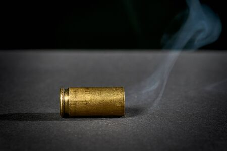Smoking bullet casing dropped on the ground