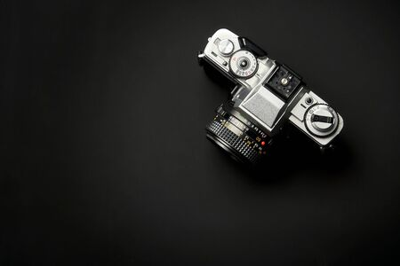 top view of a Classic analog 35 mm camera vintage on black table background 写真素材