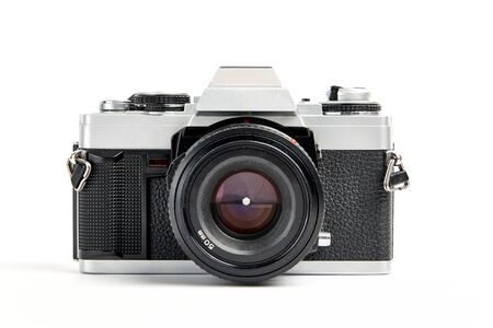 front view of a Classic analog 35 mm camera vintage and analog film rolls on white background 写真素材