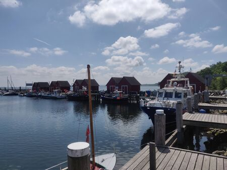 A small, idyllic fishing village in the harbor of the Baltic Sea.