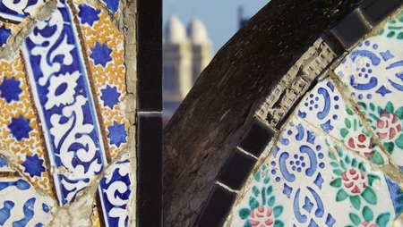colourfully: Typical colourfully painted tiles in Tunis, Tunisia. In the background a church.