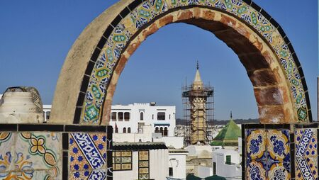 arab spring: In the old town (medina) of Tunis, Tunisia. View through archway to on a minaret. Stock Photo