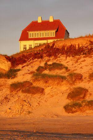 marvelous: House in the dunes in Denmark, Europe. The marvelous coast of Lokken in evening mood. Stock Photo