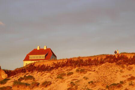 marvelous: House in the dunes in Denmark, Scandinavia, Europe. The marvelous coast of Lokken in evening light. Stock Photo