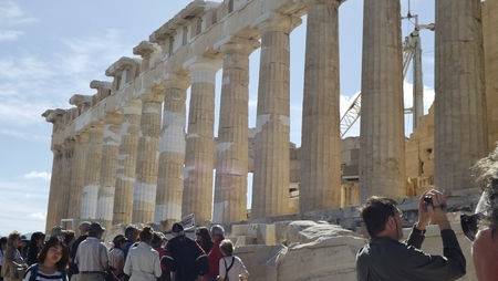ATHENS, GREECE - MAY 1, 2014. Part of the Parthenon of the Acropolis in Athens, Greece. Many visitors admire the temple.