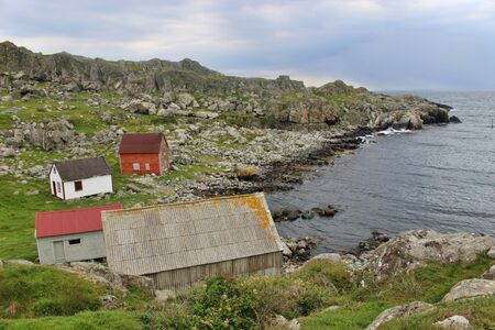 On the coast of the isle of Utsira in Norway. Some houses in a secluded bay.