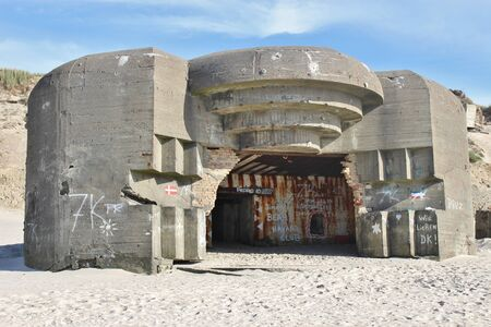 On the beach of Lokken, Denmark. Ruins of an Atlantic Wall bunker, built by the German Armed Forces in the Second World War built between 1942-1945.