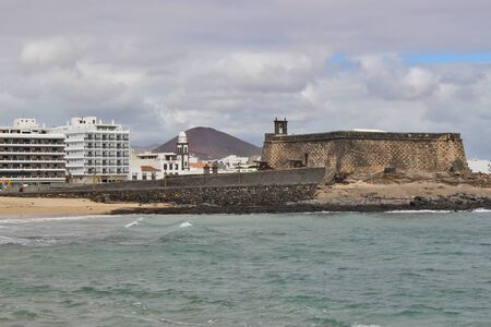 City view of Arrecife, Capital of Lanzarote, Canary Islands, Spain. The Castillo de San Gabriel in the foreground.