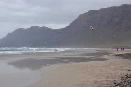 On Famara beach, Lanzarote, Canary Islands, Spain. In the background the cliffs El Risco de Famara.