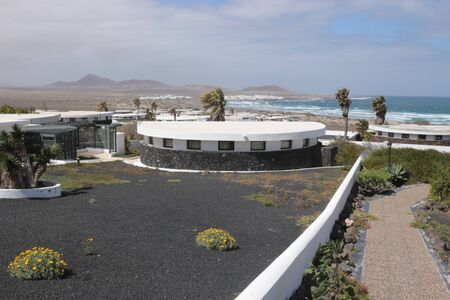 Holiday village and the beach of Famara, Lanzarote, Canary Islands, Spain. The so called Norwegian Settlement.