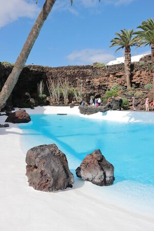 A place of contemplation: Deep blue pool in Jameos del Agua. Lanzarote, Canary Islands, Spain.