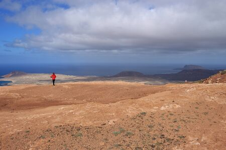 On a high plateau of the Chinijo Archipelago nature park, Lanzarote, Canary Islands, Spain. Panoramic view of the sea and of the Isle La Graciosa.