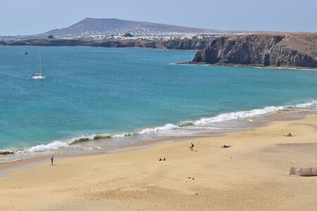 Panoramic view of the beach Playa Mujeres near the village and resort Playa Blanca. South Lanzarote, Canary Islands, Spain.