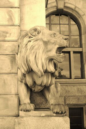 Statue of a lion in front of the New Town Hall in Hanover, North Germany, Europe.