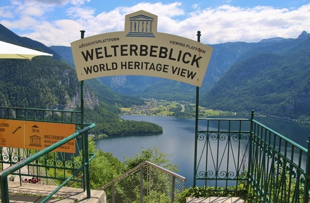 Hallstatt, Austria - June 18, 2017: The World Heritage viewing platform in Hallstatt with a spectacular view of Lake Hallstatter See and the surrounding mountains. Europe.