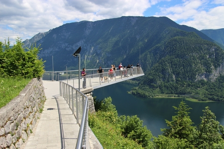 Hallstatt, Austria - June 18, 2017: The World Heritage viewing platform in Hallstatt with a spectacular view of Lake Hallstatter See and the surrounding mountains. People on it. Europe.