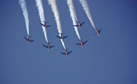 The French Armee de l'air stunt team in formation above the coast of St. Tropez