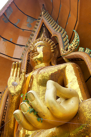 blessings: KANCHANABURI THAILAND - August 14, 2016: Wat Tham Suea  Gold big buddha statue, seated in the posture of giving blessings, Travel guide of Kanchanaburi.