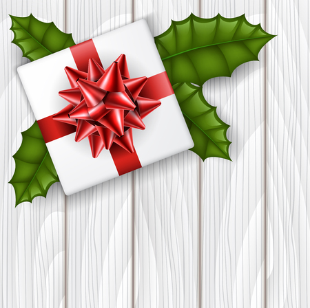 Christmas gift box from top view with red ribbon and green holly leaf. Realistic vector illustration for December holiday season, on white wood texture background, corner decoration for designs and messages