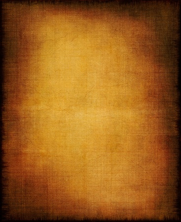 sackcloth: An old section of cloth and paper with a golden center and vignette effect. Stock Photo