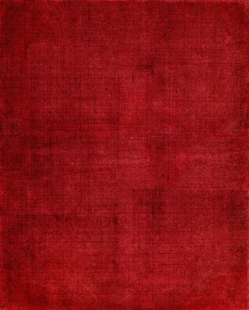 crosshatched: An old, textured cloth book cover with a red screen pattern. Stock Photo