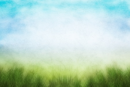 mottling: A field of fresh grass in spring with soft grunge mottling and a textured paper background.