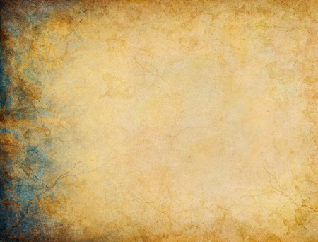 A vintage paper background with blue and gold grunge patterns and textures on the left side margin. photo