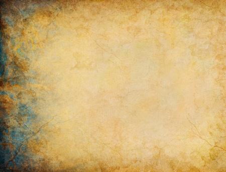 Een vintage papier achtergrond met blauwe en goud grunge patronen en texturen aan de linkerkant marge. Stockfoto